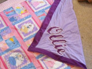 "close-up of ""Ollie"" applique"
